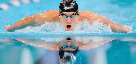 Michael Phelps swims to victory in the men's 400-meter individual medley finals at the US Olympic swimming trials in Omaha, Neb., Sunday, June 29, 2008. Phelps set a new world record of 4:05.25 in the event. (AP Photo/Mark J. Terrill)